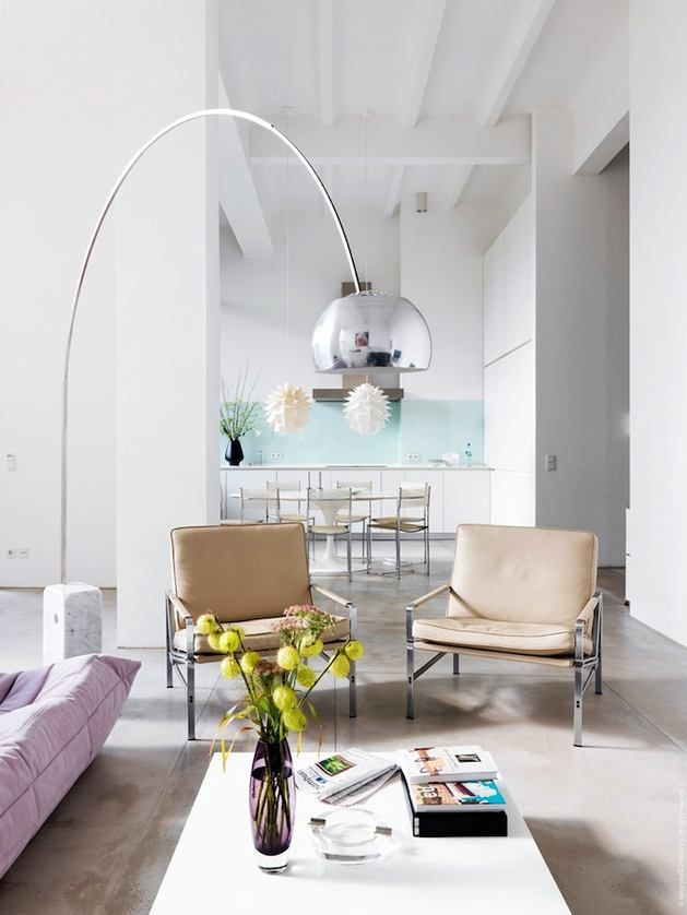 Great Modern, Pastel Living Room Inspiration Featuring The Arco Floor Lamp, A  Bright Purple Couch And A White Coffee Table.