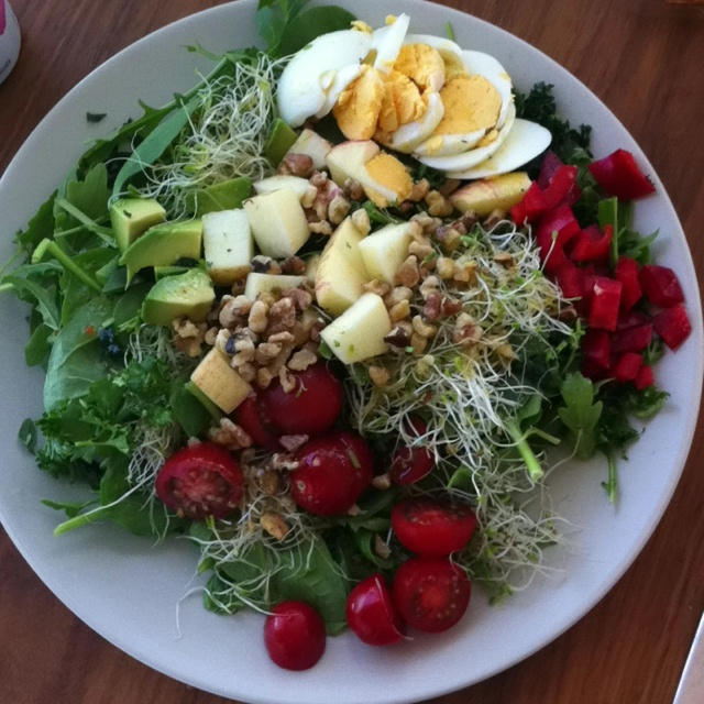 Day 5-organic Yum yum salad Spinach and Arugala mix 2 pieces of finely cut kale-stem removed 1 boiled egg 1/4 cut apple 5 cherry tomatoes halved 1/2 avocado 1/4 red pepper diced Alfalfa sprouts Parsley Walnuts Lemon oil dressing