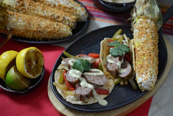 Discover a love for bratwurst with tips on how to grill brats at home and a fajita-inspired brat recipe with hatch green chile crema.
