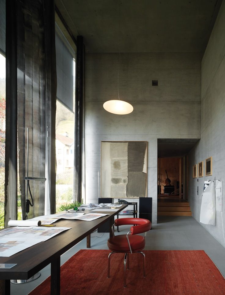 desk. Office space. Modern. Concrete and glass. Red, black, and grey. Contemporary. Leather office chair. Bamboo floor
