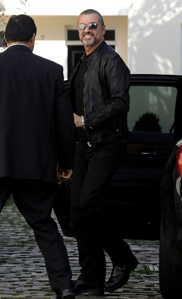 George Michael returns back to his home following his interview on Radio 2.