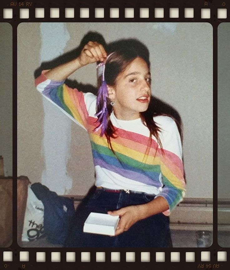 The perfect #80s combo: the rainbow tee with the feather roach clip.  Hello, 1982, we miss you! http://www.liketotally80s.com/2011/08/feather-roach-clips/