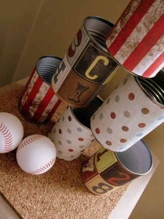 Vintage Carnival-Style Tin Cans - As seen on Catch My Party, create these vintage carnival-style tin cans to use as decor or for carnival party games. {DIY Tip} Collect empty tins that have been cleaned. Using vintage and carnival-style wrapping paper with letters, stripes or dots to fit the height and the circumference of the tin. Using cold adhesive, paste the paper onto the tin and allow to dry