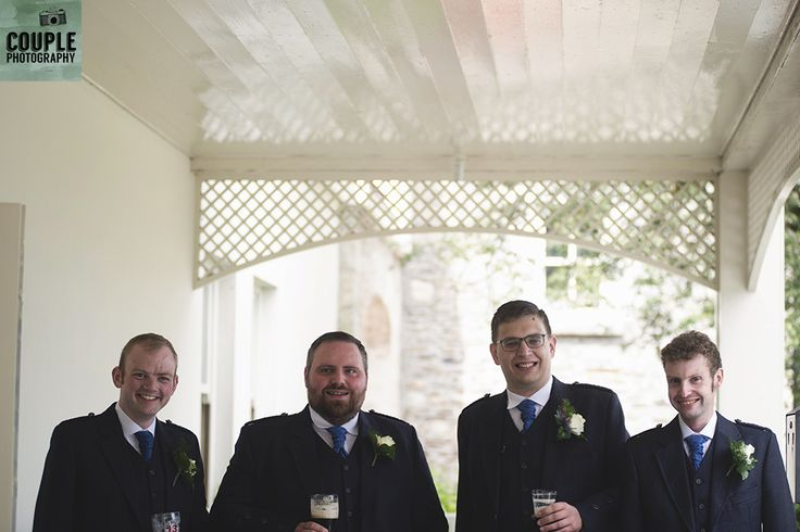 The groom and his groomsmen have a quick pint before the wedding ceremony. Weddings at Tulfarris Hotel & Golf Resort photographed by Couple Photography.