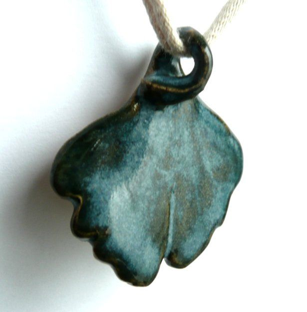 Ceramic Jewelry Pendant for Necklace - Stoneware Ginkgo Tree Leaf Dark Blue Green. $11.95, via Etsy.