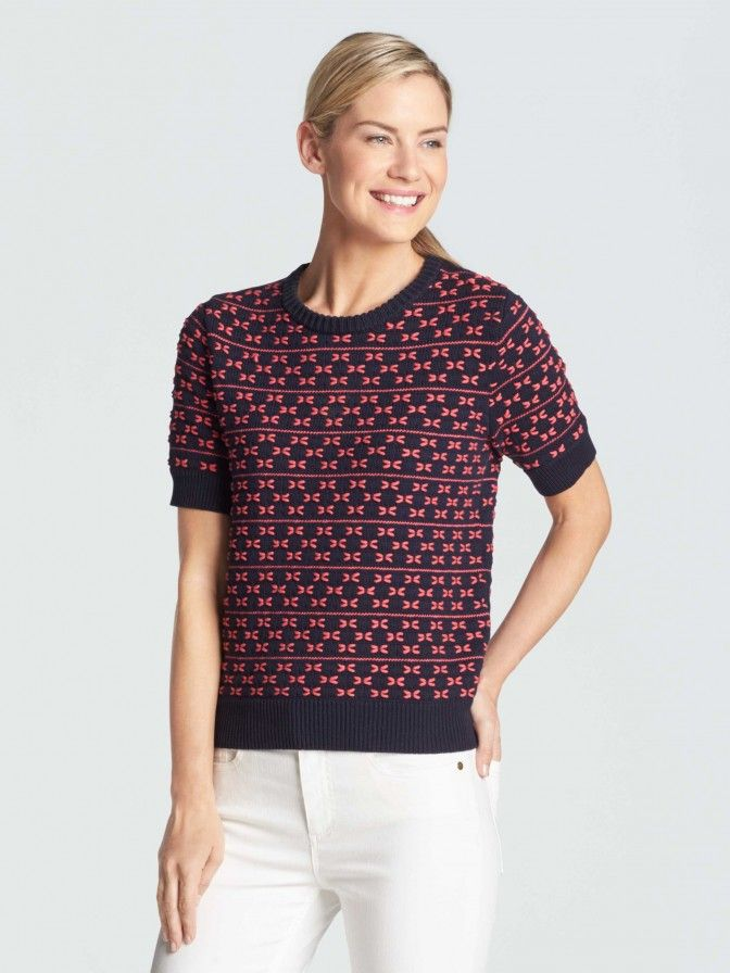 """We kicked the sweater up a notch. With short sleeves, a thicker yarn and a bow-effect stripe, this one has """"ladylike cool"""" written all over it."""