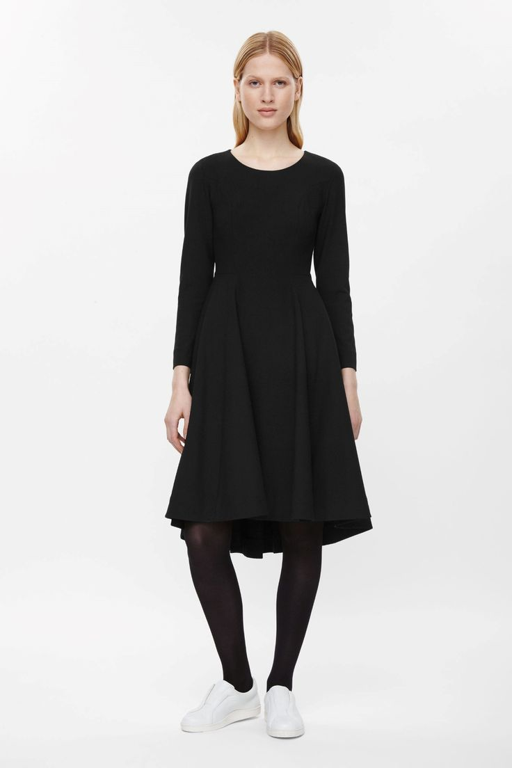Fitted across the chest and with a pleated flaring skirt, this dress is made from a comfortable material with a slight stretch. Coming in at the waist, it has a round neckline, panel detailing and two in-seam pockets. It is secured with a hidden zip fastening on the back.