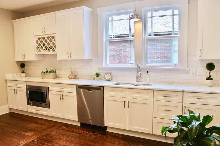 Prime Design Memphis Llc White Kitchen Beveled Subway Tiles Shaker Cabinets Hardwood Floors Wine Rack Kitchen Beveled Subway Tile Shaker Cabinets