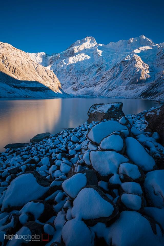Winter touches Aoraki Mount Cook National Park: Mueller Lake, Mount Sefton and The Footstool. Hooker Valley.