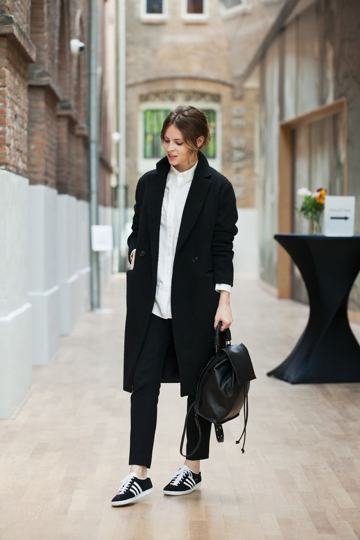 black wool coat + white dress shirt + black ankle pants + black leather  backpack + black and white Adidas