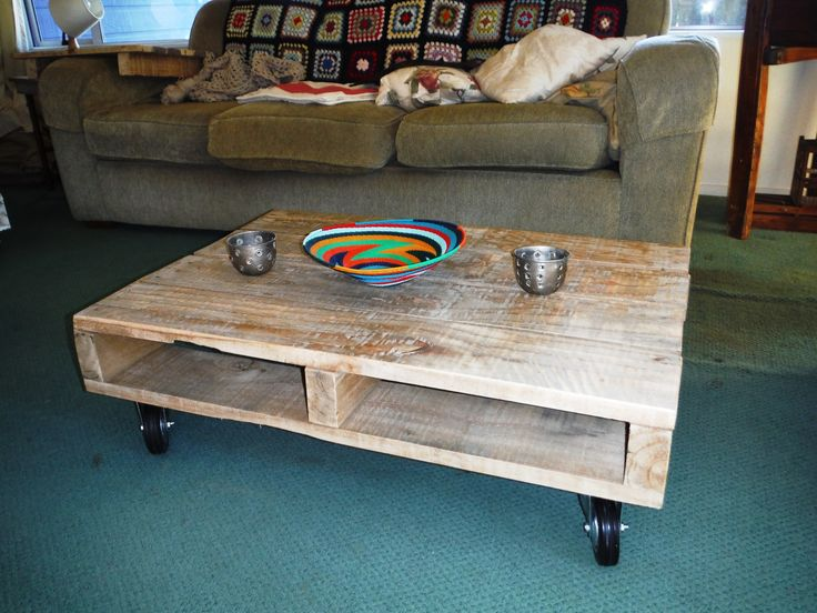 Recycled palette is now a coffee table on wheels.