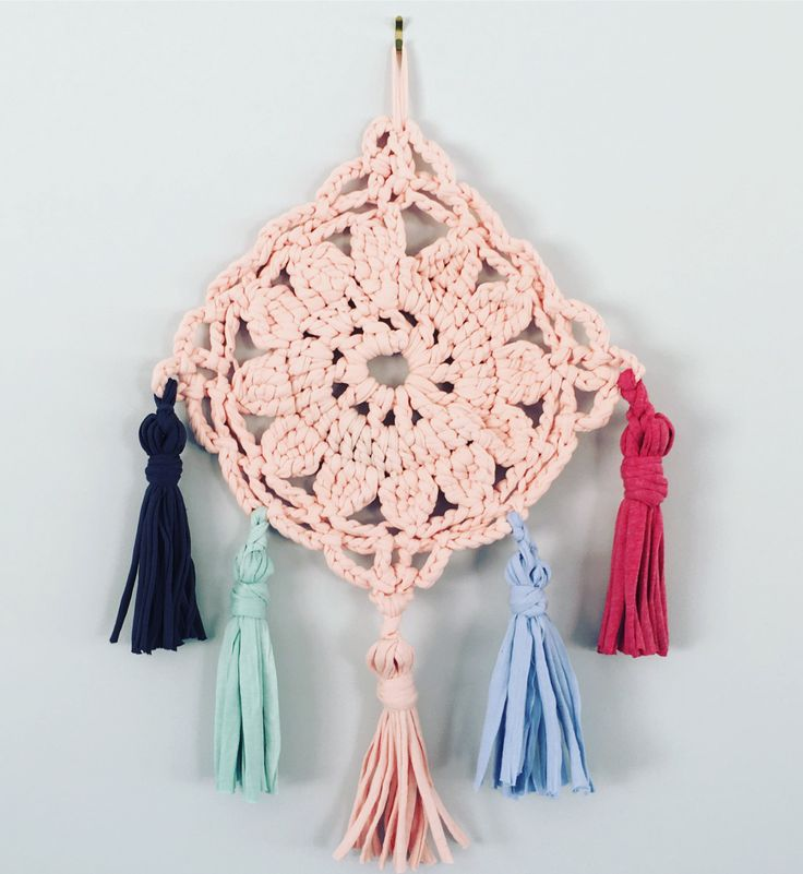 Baby pink crochet doily diamond wall hanging with mint, blue, strawberry and blue/grey tassels by waffleandweave on Etsy