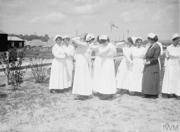 WWI, 1 June 1917, France; American nurses, probably at the US Army Base Hospital No 4, attached to No 9 General Hospital, situated at Le Madrillet in the southern suburb of Rouen. ©IWM Q 2336