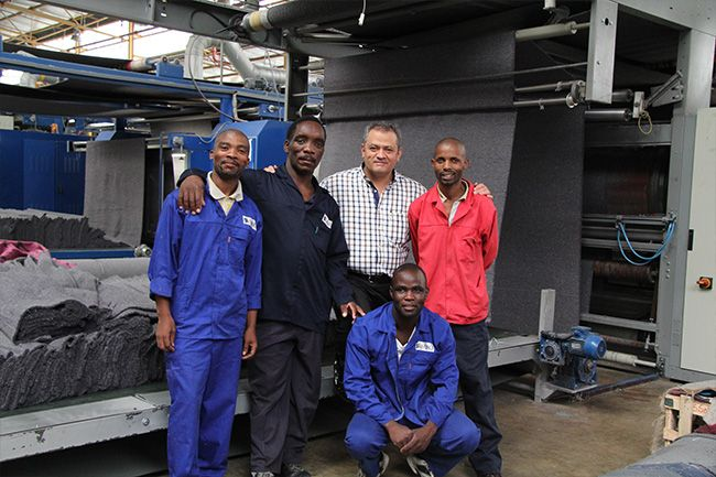 Mr Sesli with some of the friendly staff at the Manufacturing Shop