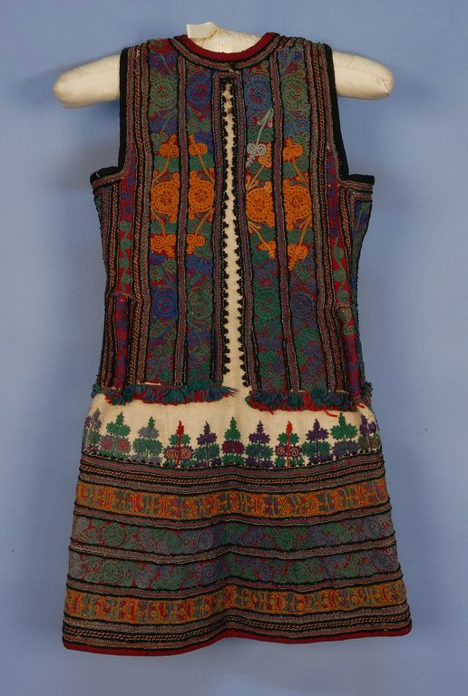 Albanian wool jelek or xhamadan vests, heavy white felt nearly completely covered in colorful soutache, cording and applique having small inside gingham pocket, late 19th c, back