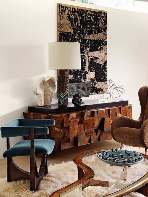 Paul Evan's sculpted burl walnut sideboard and one of Evan's cast bronze side chairs, Edward Lane coffee table, and a Michel Contessa lounge chair.