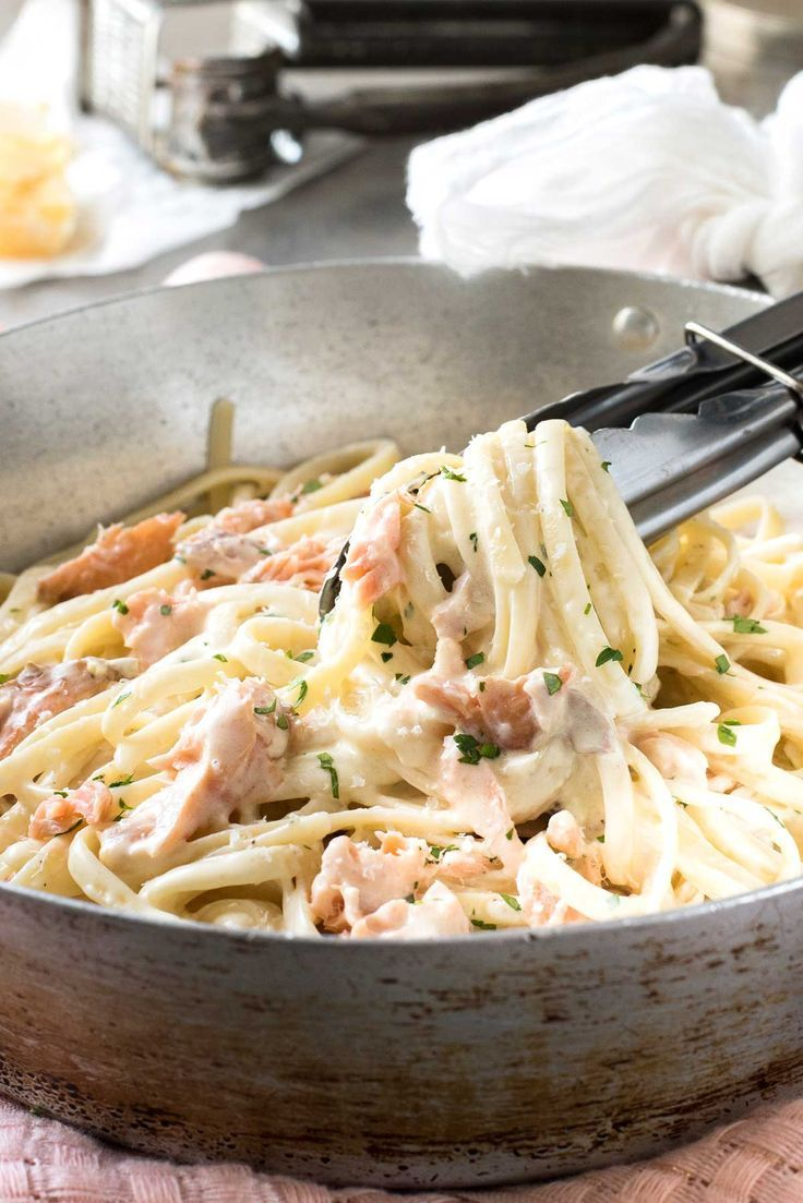 """Pasta tossed with a creamy parmesan sauce and flakes of salmon. Alfredo pasta madethe real proper restaurant way, you only need 1/2 cup of cream to serve 3. It's simple, it's magic, it's the way real Italian pastas are made. No need to drown it in cream! I've written before about the""""proper"""" way to make …"""