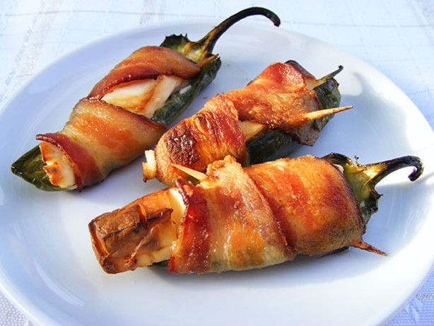 Roast jalapeno peppers stuffed with cream cheese and wrapped in bacon.   These are a little time consuming, but the results are delicious.  Prep time includes time to grill the peppers.  You can let your imagination go wild and adjust the recipe by adding anything you think sounds good.  Cream cheese measurement is an estimate because of the difference in pepper sizes. Thanks to Chuck who makes these and takes them to all the neighborhood cookouts and potlucks.  He often goes home with ...
