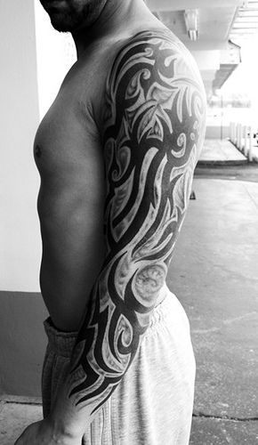 tribal-tattoo-design-on-left-arm : Tribal arm tattoos attract and fascinate the onlookers and hardly miss anyone's  eyes.