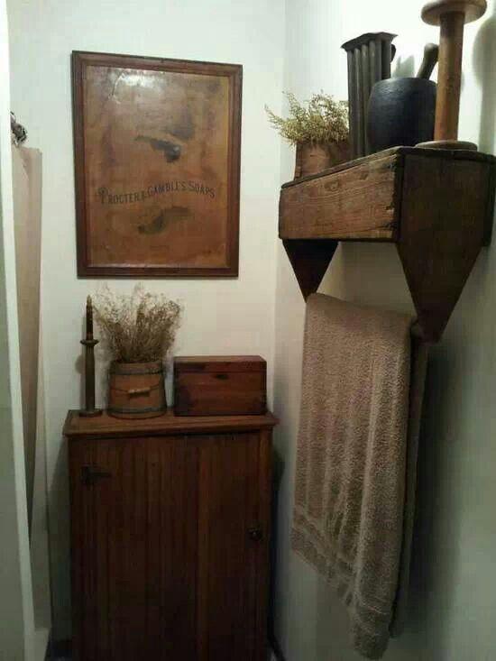 Repurpose old tool box for shelf and towel rack