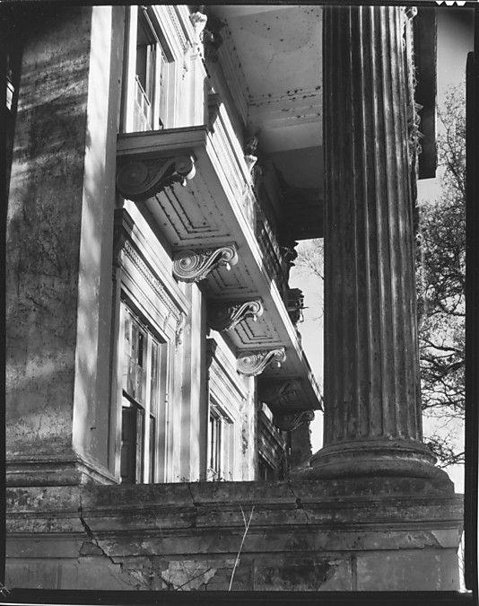 [Oblique View of Bracketwork on Belle Grove Façade Through Columns, White Castle, Louisiana] Walker Evans, 1935