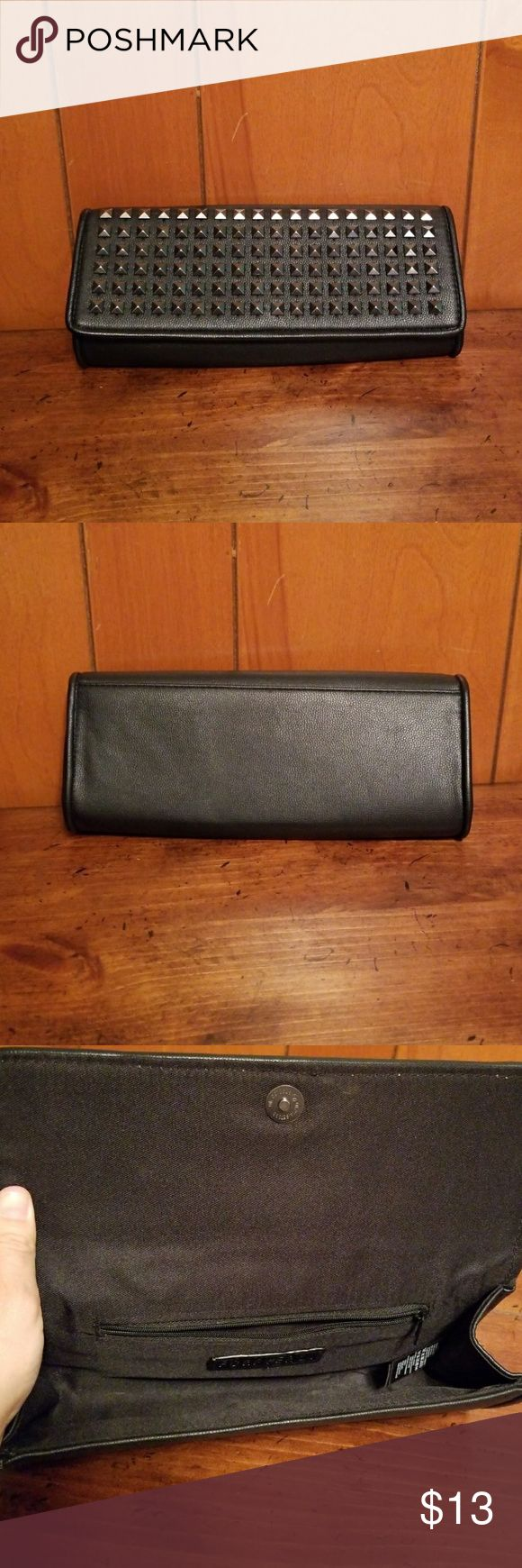 Forever21 studded clutch Ladies forever21 black leather studded clutch. Excellent condition no rips stains or tears. Measurements are 11in long 4.5 tall. All reasonable offers will be considered. Forever 21 Bags Clutches & Wristlets
