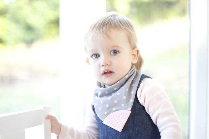 Neckerchew #teethingbaby is soft, lined, AND reversible! Polka Dot Pink #cheekychompers