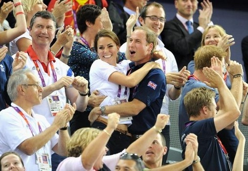 The Duke and Duchess of Cambridge celebrate as Philip Hindes, Jason Kenny and Sir Chris Hoy of Great Britain win the gold and a new world record in the Mens Team Sprint Track Cycling final.