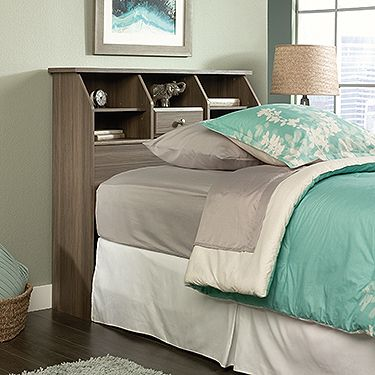Attaches to twin size bed. Spacious display area for alarm clock and books features two adjustable shelves and hidden storage behind flip-up drawer front. Enclosed back panel has cord access. Diamond Ash finish.