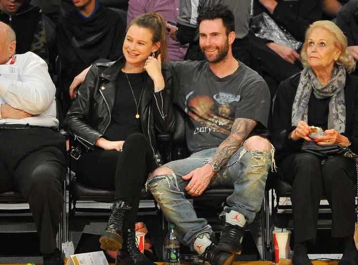 Behati Prinsloo & Adam Levine from The Big Picture: Today's Hot Photos  Relationship goals! The duo is spotted at the Lakers game.