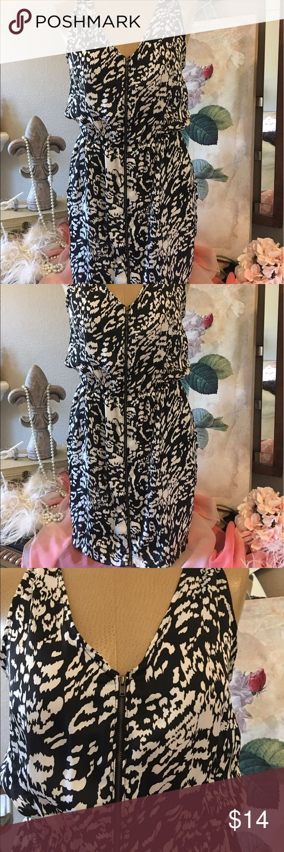 """Black & White zip up dress size Medium Cute! Black & White zip up dress size medium. Has two front pockets. Measures 18 1/2"""" arm pit to arm pit, 12"""" across at waist but it stretches and 34"""" shoulder to hem. 💯 polyester. In very very good condition. Brand is by Black. From ANGL. ANGL Dresses Mini"""