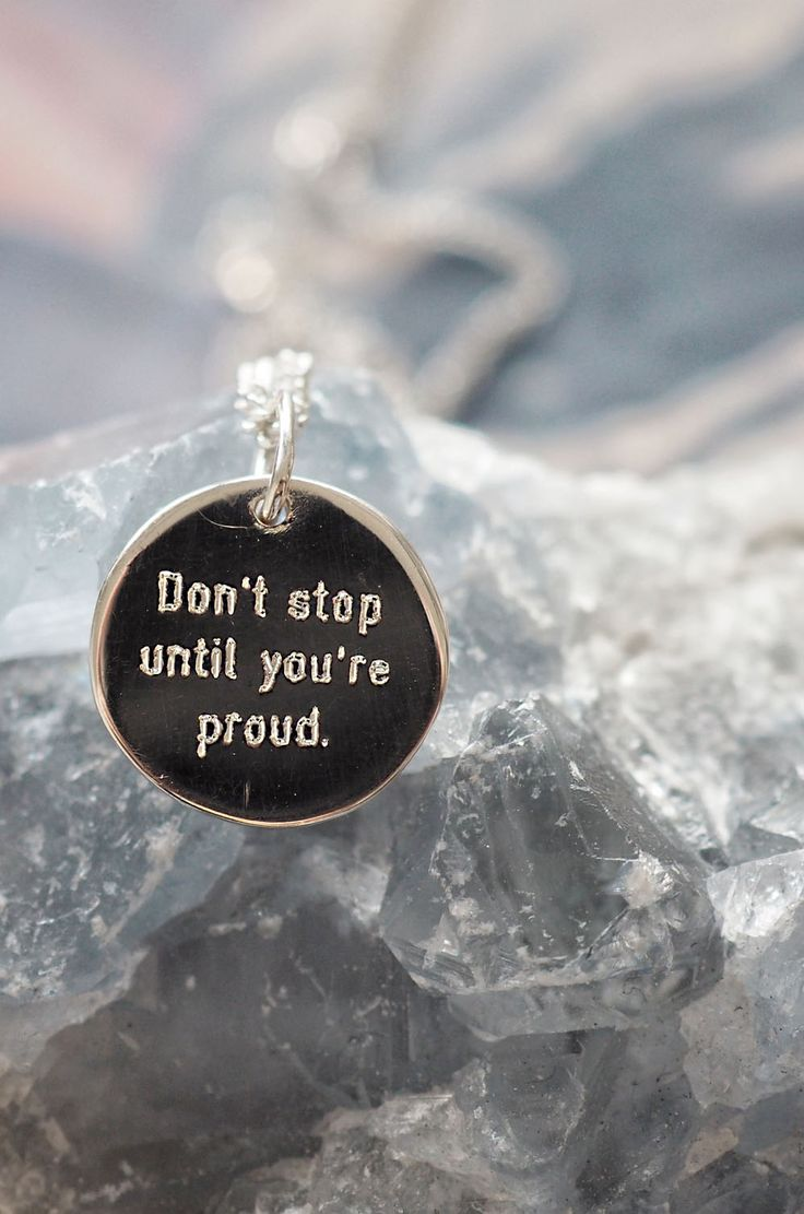 """Tiny minimalist sterling silver round pendants with simple font motivational saying """"Don't stop until you're proud"""""""