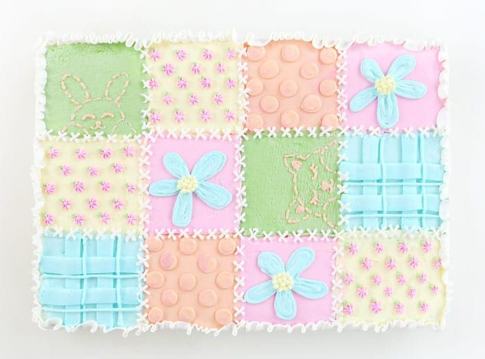 This all-buttercream Quilt Cake is a sweet little tribute to everything baby. It could be made for a pregnancy announcement, a baby shower, even a 1st birthday. Or heck, you could make it if you are over 40 and done having babies and got to hold a sweet little precious angel and now your ovaries...