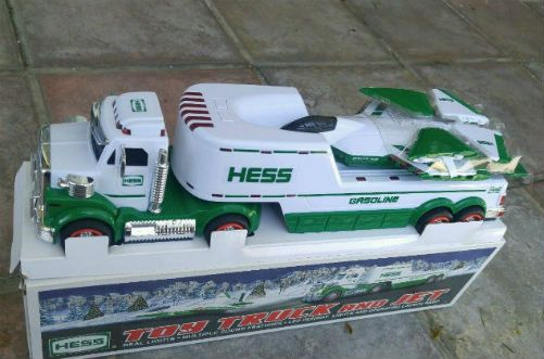 Vintage 2010 Hess Toy Truck and Jet. Did someone say Jets? No not the football team. That's right 2010 Hess Toy Truck and Jet is a first for the toy fleet. The first jet ever! The tractor-trailer that transports the jet showcases a hydraulic-lift launch pad adorned with runway lights. The jet is modeled after the amazing F-22 Raptor. Wait it gets better; there are motion-triggered sounds that truly set it apart. This is a truly innovative toy design for Hess. If you hold the toy flat you…