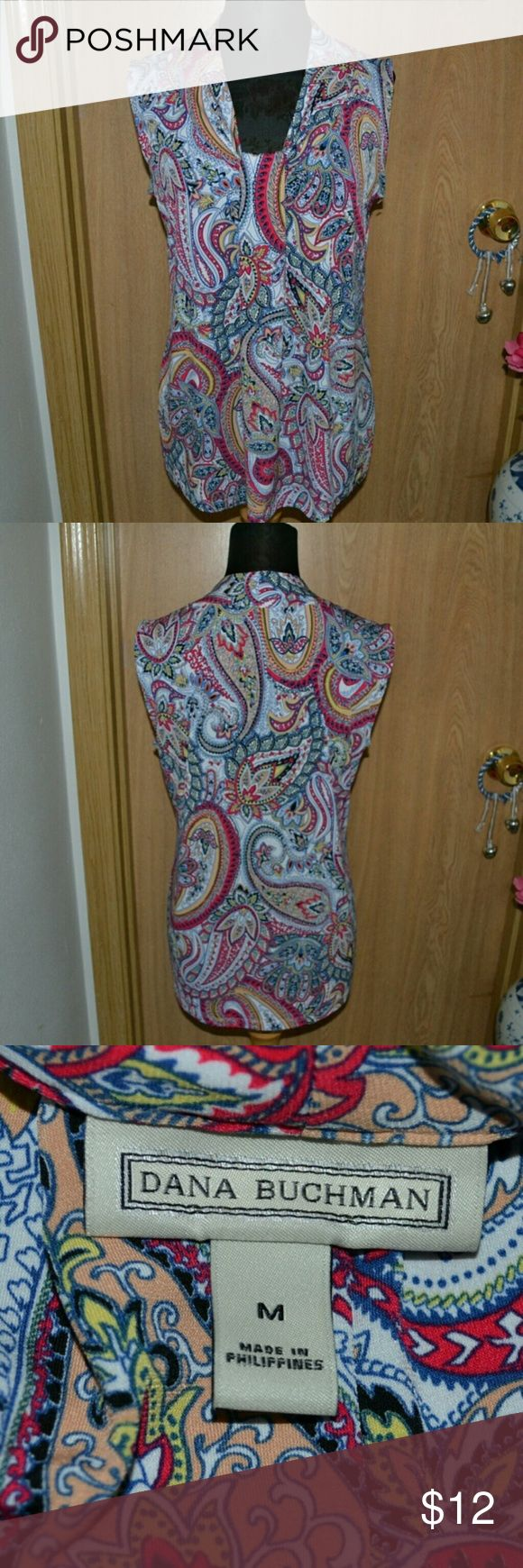 Dana Buchman paisley blouse Smoke free home ! I ship Monday- Friday ! A gorgeous, colorful sleeveless blouse by the brand Dana Buchman size medium . I don't know what the materials are. In very good Condition. INVENTORY BLUSAS B BIN Dana Buchman Tops Blouses