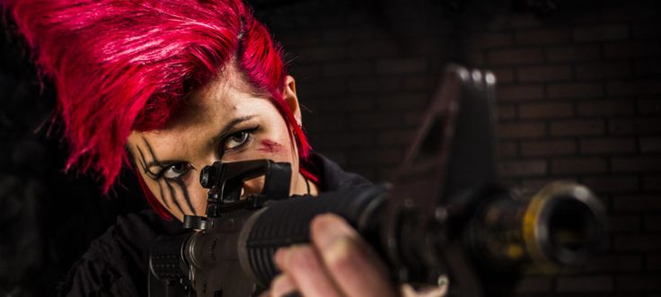 Girl looking down the gun