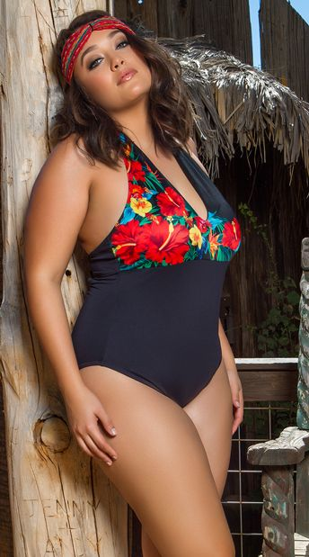 f3fc667611 Relax poolside in this exclusive plus size swimsuit featuring a V-neckline,  halter straps, soft cups with a colorful floral design, a back hook  closure, ...