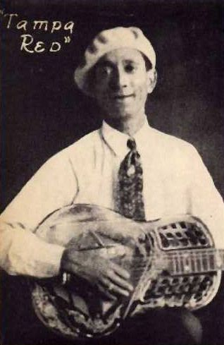 """'The Guitar Wizard' Tampa Red      [b. 1904 - d. 1981]  Also known as """"the Guitar Wizard,"""" the blues musician Tampa Red was a master of the slide guitar and one of the most prominent figures of the Chicago, Illinois, blues scene during the 1930s and 1940s. Though little known today, he was a popular and influential performer whose recording career extended from 1928 to 1960."""