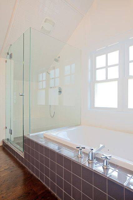 Our shower is right next to our tub just like this.  It would be so nice to have the open feeling of having the glass there instead of the wall