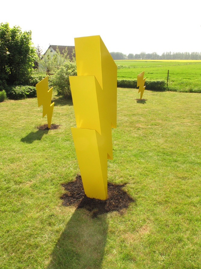 Three Lightning Bolts  Year: 2010  Technique: Solid Sheet Metal  Dimensions: 1.5 – 2 meters    The artwork consists of three stylized lightning bolts that scorched the grass where they hit.