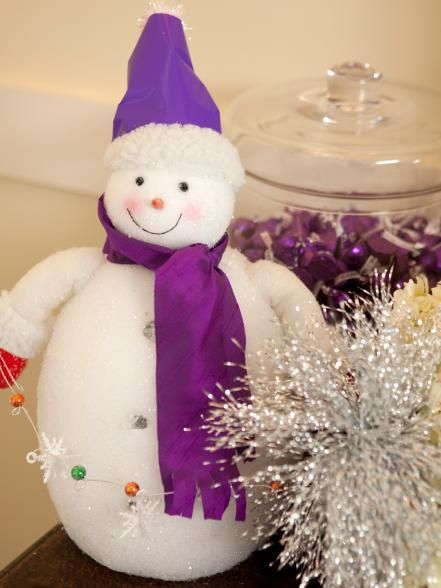 Mix a regal-purple color palette with funky 1970s style to get holiday decor that is elegant and fun.