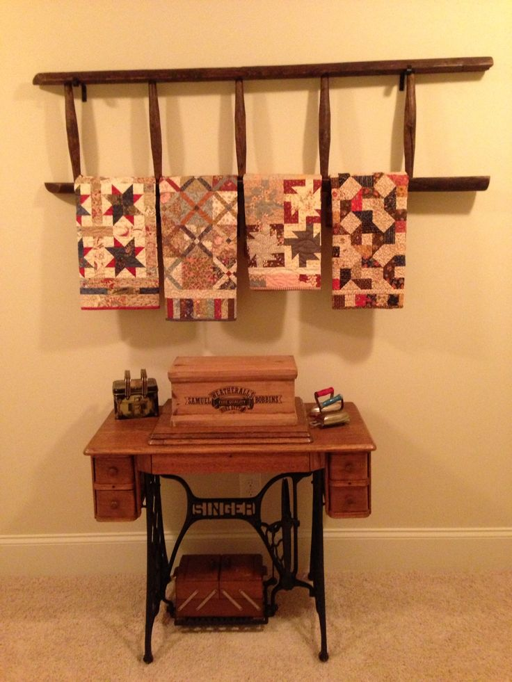 Old ladder, quilts....love the look!