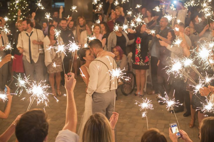 """One of my very favorite parts of the reception was our first dance,"" Andrea says. The guests held sparklers around the couple as they danced together. ""It was so romantic, and a great way to include our guests in the dance,"" Andrea says."