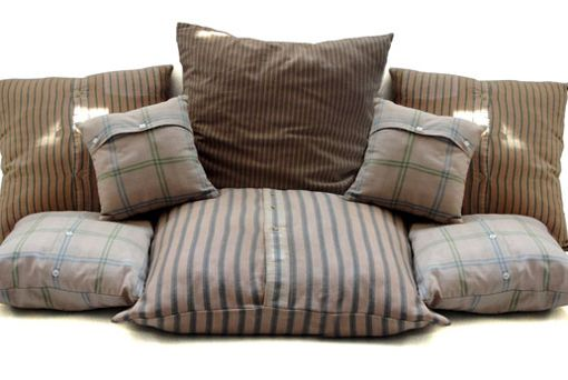 Pillow covers made from shirts!! EasyShmeazy Brilliant! The buttons let you take the cover off for cleaning,