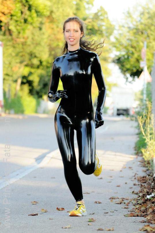 Model (aka Princess Fatale) jogging in latex catsuit