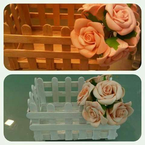 Caixote de palitos com flores