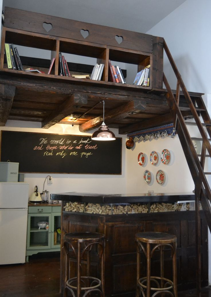 Kitchen with library above  @ Felinarul Residence