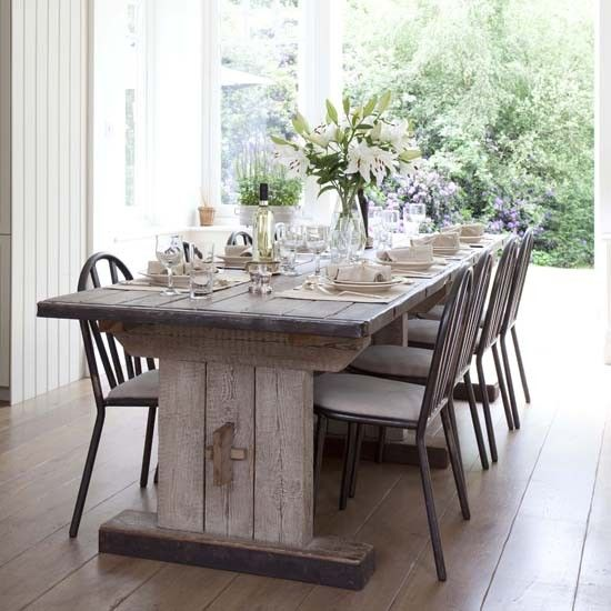 Statement furniture, such as a limewashed, scrubbed oak dining table, will add wow factor and an elegant, rustic feel to a dining room. Don't use a tablecloth to allow the wood to be the star of the show