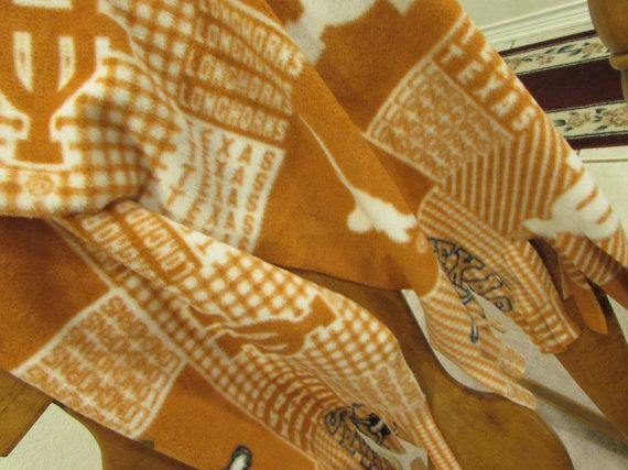 Attention UT fans! Here is a terrific addition to your UT college memorabilia. This University of Texas scarf is perfect to wrap around your neck on a chilly day or it just looks great hanging on your jacket! This particular scarf is muffler length at 54 with fringe on both ends, and is 12 wide. Go ahead - show your true colors