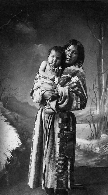Sarcee (or tsuu T'ina) Woman, Katie, and her Baby, via Flickr. The Tsuu T'ina are a Athabaskan or Dene First Nations group in the Alberta province near Calgary.